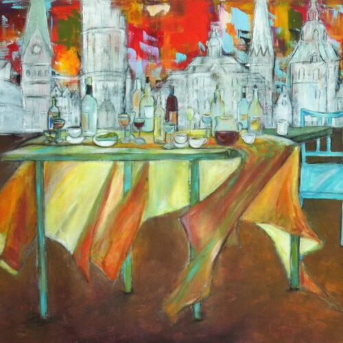 """Das Bild """"Lüneburg - Ein Fest"""" zeigt im oberen Teil einen bunten expressiven Hintergrund mit einer weißen Skyline von Lüneburg davor mit den Wahrzeichen Alter Kran, Johanniskirche, Wasserturm, Rathaus, Nicolaikirche, Michaeliskirche und einige typische Hansegiebelhäuser. Im unteren Bereich des Gemäldes sind ein Tisch mit wehender Tischdecke und ein blaue Stuhl links zu sehen. Auf dem Tisch sind verschiedene Weinflaschen, Gläser, Kaffeetassen und Teller angeordnet."""