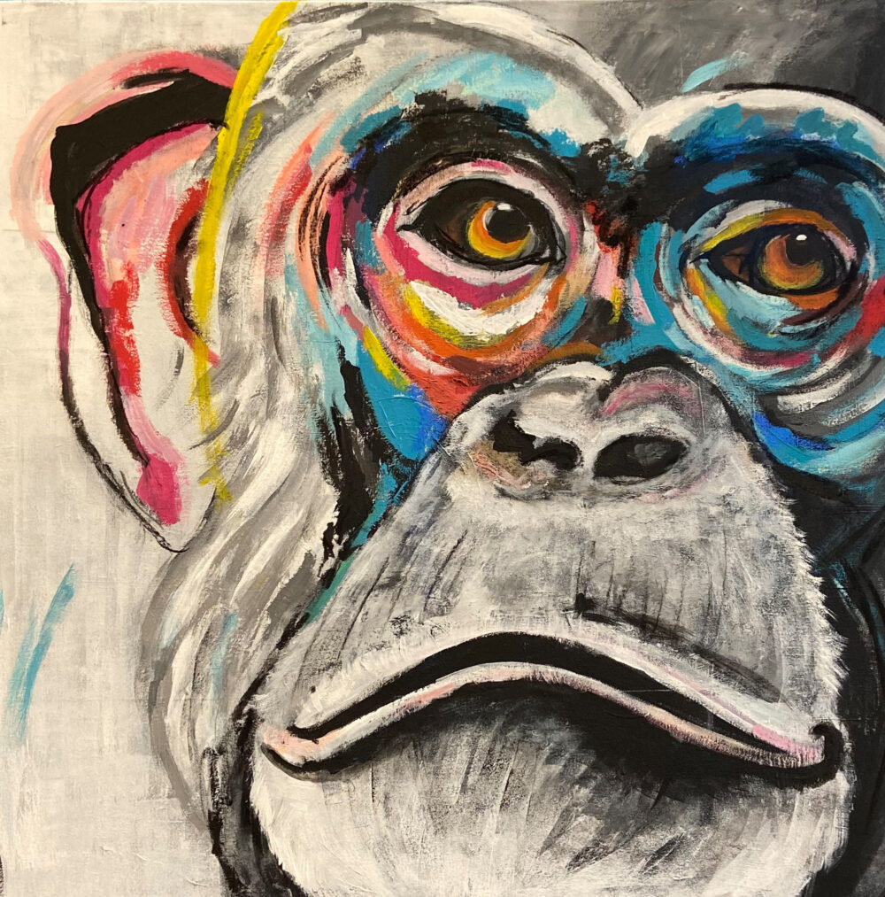 Das Gemälde Schimpansenporträt zeigt ein Schimpansengesicht in schwarz weiss mit bunten Akzenten um die Augen